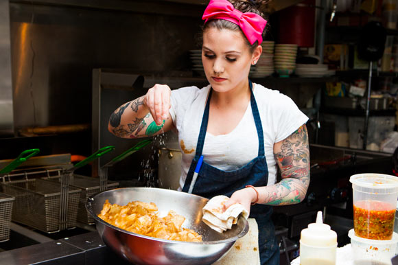 Sonia Mondino prepares fresh house-made chips.