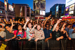 Crowd of music fans in Yonge-Dundas Square.